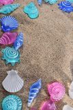 Background with plastic summer motifs. Summer background with seashells and starfish on the beach sand. summer concept Royalty Free Stock Image