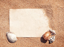 Summer background with sheet of paper and seashells Royalty Free Stock Photography