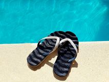 Flip flops by the swimming pool. summer concept royalty free stock image