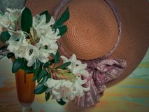 Summer background with straw hat and flowers royalty free stock photography