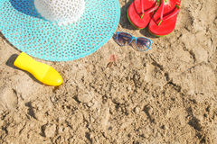 Summer background. Sunglasses suntan lotion hat and slates on be Stock Photography