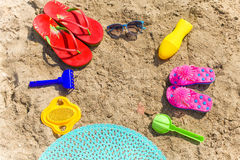 Summer background. Sunglasses suntan lotion hat and slates on be Stock Photos