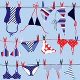 Summer background; swimsuits. Royalty Free Stock Images