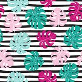 Summer background with tropical leaves. Seamless floral pattern. Vector texture. stock photography