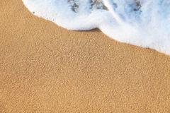 Summer background - wave of the sea on the sandy beach Stock Images