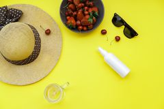 Summer background on the yellow table: Straw Hat, soda, berries Royalty Free Stock Photography