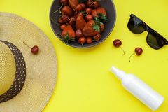 Summer background on the yellow table: Straw Hat, soda, berries Stock Images