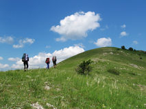 Summer backpacking. Three tourists in Crimean hill Royalty Free Stock Photos