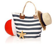 Summer bag with beach ball and straw hat. Isolated on white Stock Images