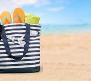 Summer. Bag leisure shore sunglasses tropical sunbath Royalty Free Stock Image