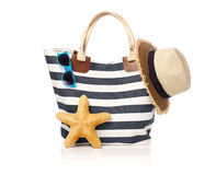 Summer bag with sunglasses, starfish and straw hat Stock Photos