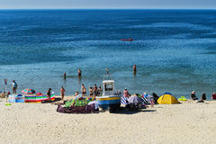 Summer Baltic sea beach with sunbathers in Stegna, Pomerania, Poland. Royalty Free Stock Photos