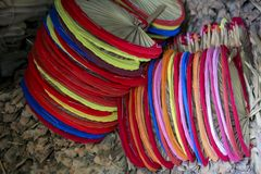 Bangladeshi made colorful Hand held fan. In Summer Bangladesh`s weather become very hot above 40-45 degree calices. Once the peoples were depending on hand held Stock Photography