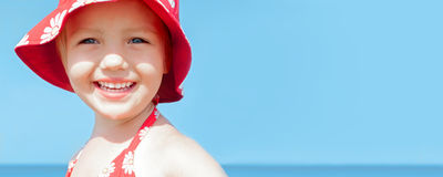 Summer banner child girl happy smile sea holidays Stock Photos
