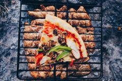Summer barbecue with chicken. Dinner. Summer barbecue with chicken and pizza. Dinner or lunch Royalty Free Stock Photos
