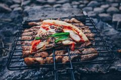 Summer barbecue with chicken. Dinner. Summer barbecue with chicken and pizza. Dinner or lunch Royalty Free Stock Images