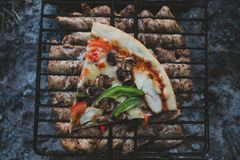 Summer barbecue with chicken. Dinner. Summer barbecue with chicken and pizza. Dinner or lunch Stock Images