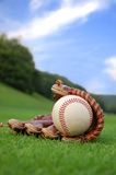 Summer baseball. Close up of a baseball glove on the grass Royalty Free Stock Images
