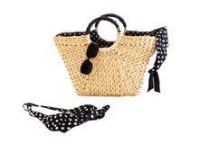 Summer: basket, sunglasses, bikini isolated white. A summer inspired still-life royalty free stock photography