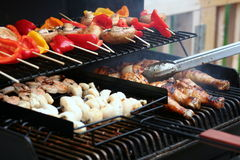 Summer BBQ. Outside having a juicy BBQ dinner stock photo