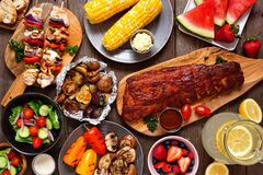 Free Summer BBQ Or Picnic Food Top-down View Table Scene Over A Dark Wood Background Stock Photography - 183772362