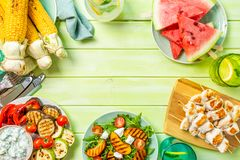 Summer bbq party concept - grilled chicken, vegetables, corn, salad, top view. Copy space royalty free stock images