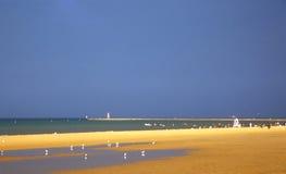 Summer beach. Long, open sandy beach in summer Royalty Free Stock Image