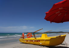 Summer beach. And a yellow lifeboat Royalty Free Stock Photos