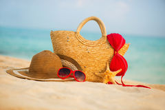 Summer beach with accessories. Blur azure sea on background Stock Image