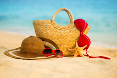 Summer beach with accessories. Blur azure sea on background Stock Photos