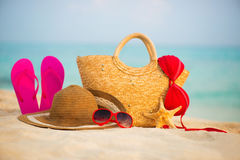 Summer beach with accessories. Blur azure sea on background Royalty Free Stock Photos