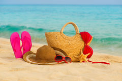Summer beach with accessories. Blur azure sea on background Royalty Free Stock Image