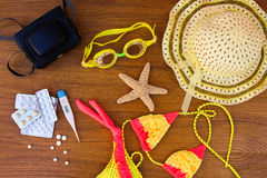 Summer beach accessories and medicine on the table. Royalty Free Stock Images