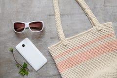 Summer beach accessories slipper clutch skirt sunglasses Stock Photos