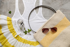 Summer beach accessories slipper clutch skirt sunglasses Royalty Free Stock Photos