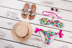 Summer beach accessories, wooden background. Royalty Free Stock Image