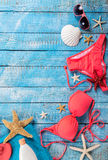Summer beach accessory on the wood table. Royalty Free Stock Image