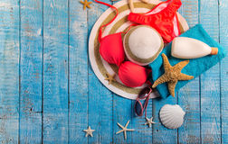 Summer beach accessory on the wood table. Stock Image