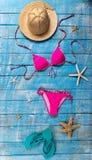Summer beach accessory on the wood table. Stock Photos