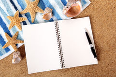 Summer beach background with blank writing book, copy space Royalty Free Stock Image