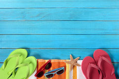 Summer beach background border, sunglasses, flip flops, copy space. Summer beach objects border, sunglasses, flip flops, copy space royalty free stock photography