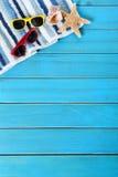 Summer beach background border, sunglasses, towel, starfish, vertical Stock Photo