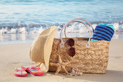 Summer beach bag on sandy beach Stock Image