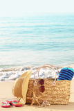 Summer beach bag on sandy beach Royalty Free Stock Photos