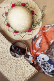 Summer beach bag and straw hat. Beach bag, sunglasses and straw hat on wooden background. Concept of vacation, relaxation Royalty Free Stock Photography
