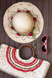 Summer beach bag and straw hat. Sunglasses, bag and straw hat on wooden background. Concept of vacation, relaxation Stock Image