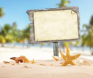 Summer beach with blank wooden poster royalty free stock image