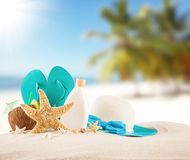 Summer beach with blue sandals and shells Stock Photography