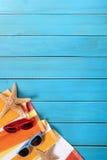 Summer beach border, blue wood decking background, copy space, vertical Stock Photos