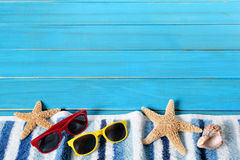 Summer beach border, starfish, sunglasses, blue wood, copy space Stock Photography